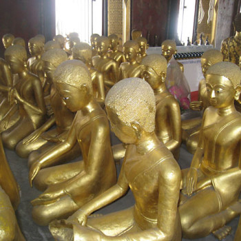 52 bhikkhuni statues with individual features.