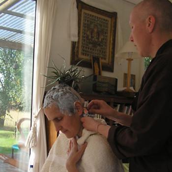 Ajahn Anandabodhi shaves Shirley for her Anagarika Ceremony, Amaravati