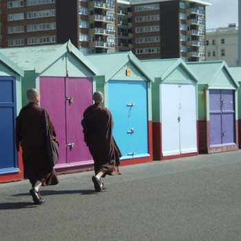 Ajahn Thanasanti & Ajahn Santacitta walking past bathing huts at Brighton Beach, UK, 2008