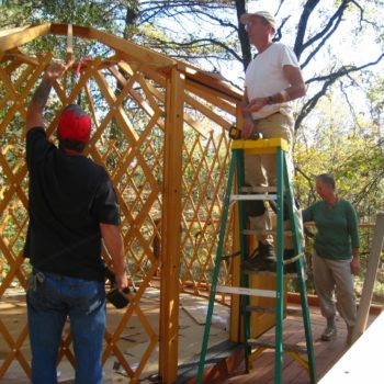 Robert, yurt builder extraordinaire, in action with his team