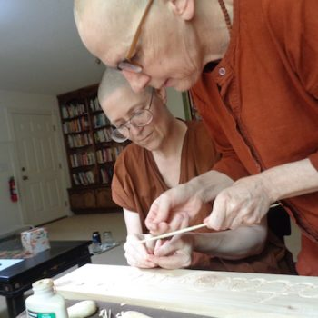 Carving a gratitude sign for Robert